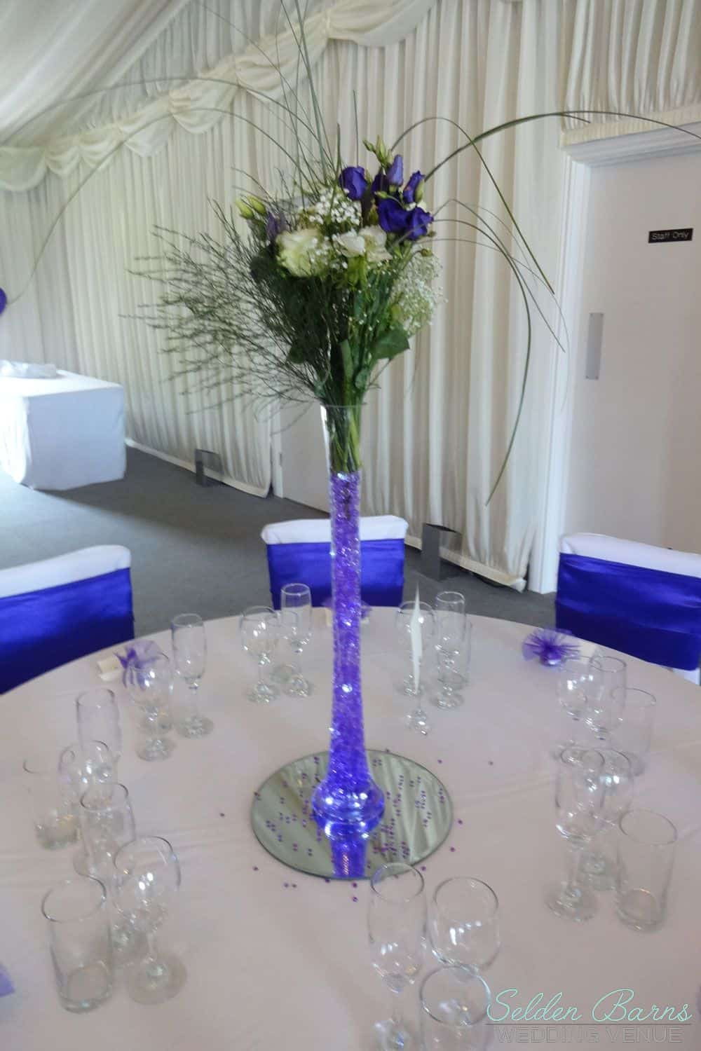 Flowers selden barns blue and white floral arrangement in a glass flute with blue glass beads reviewsmspy